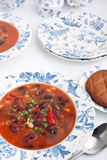 Bean soup in a blue patterned plate Royalty Free Stock Image
