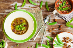 Bean soup in bowl with fresh green pea Royalty Free Stock Photos