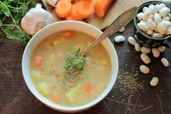 Bean soup. Bowl with bean soup and herbs Royalty Free Stock Image