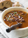 Bean soup. A bowl of homemade chili bean soup with meat, selective focus Stock Photography