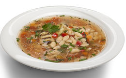 Bean soup in a bowl. Isolated over white Royalty Free Stock Images
