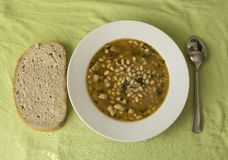 Bean soup and bread glance. Plate with bean soup and bread Stock Photos