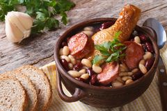 Bean soup with chicken legs and sausages in a bowl Stock Photos