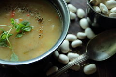 Bean soup with a fresh herbs Stock Photography