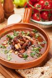Bean soup. Kidney bean soup with bread and cherry tomato Royalty Free Stock Image