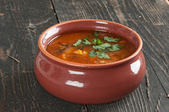 Bean soup and parsley on the table Stock Photography