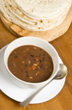 Bean Soup and Pita Bread. Bean soup and a pile of pita/naan bread royalty free stock images