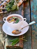 Bean soup with sage leaf. In to white table Stock Photography