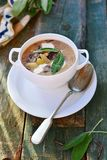 Bean soup with sage leaf Royalty Free Stock Photos