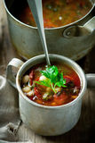 Bean  soup and sausages and metal mug. Stock Images