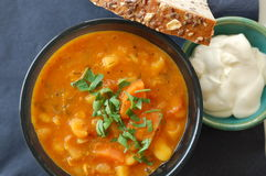 Bean soup, sour cream and bread Stock Image
