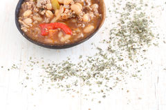 Bean soup. On a wooden spoon Stock Photo