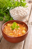 Bean soup on wooden table Stock Photography