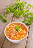 Bean soup on wooden table Royalty Free Stock Image