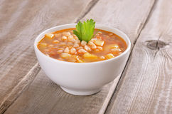 Bean soup on wooden table Royalty Free Stock Photo