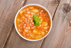Bean soup on wooden table Royalty Free Stock Photos