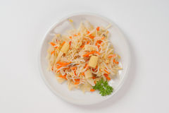 Bean sprouts salad. Bowl of carrot and bean sprouts salad on white background Stock Photos