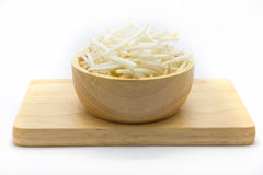 Bean sprouts on wooden plate. Cutting bean sprouts on wooden plate, white background Stock Images