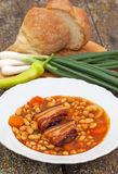 Bean stew with bacon. And vegetables Royalty Free Stock Image