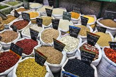Bean types. CURITIBA, BRAZIL - OCTOBER 7, 2014: Municipal market in Curitiba, Brazil. The market dates back to 1820s. Curitiba is the 8th most populous city of Royalty Free Stock Images