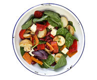 Bean and Vegetable Salad. Salad with roasted vegetables, kidney beans, and baby spinach leaves, in old enamel bowl.  Clipping path included Stock Photography