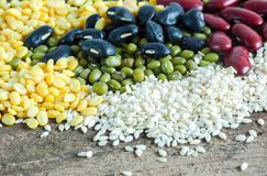 Bean and white sesame seeds pile on wood Royalty Free Stock Photos