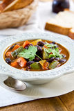 Bean with zucchini and carrot soup. By some bread stock images