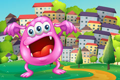 A beanie monster shouting at the hilltop across the buildings Royalty Free Stock Image