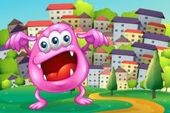 Beanie potwór krzyczy przy szczytem przez budynki Obraz Royalty Free