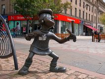 Beano Minnie. Monument to the hero of the British comics Beano Minnie with a slingshot in the center of the Scottish city of Dundee stock photos