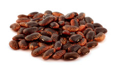 Beans. Brown beans over a white surface Stock Images