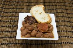 Beans. Stew of beans with sausage, blood sausage and bacon royalty free stock images