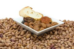 Beans. Stew of beans with sausage, blood sausage and bacon stock photography