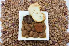 Beans. Stew of beans with sausage, blood sausage and bacon royalty free stock image
