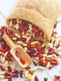 Beans. Raw colored beans in a bag on the table royalty free stock photo