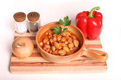 Beans. Delicious beans with sausages and tomatoes Stock Images