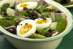 Beans, bacon and egg salad. On green table Royalty Free Stock Photo