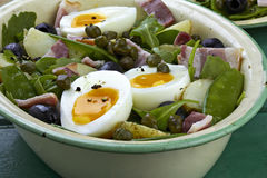 Beans, bacon and egg salad. On green table Stock Photo