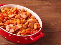 Beans and bacon prepared for baking in oven Stock Photos