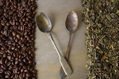 Beans of black coffee and  green tea leaves Stock Photography