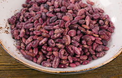 Beans in bowl on wooden table Stock Photography