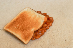 Beans carpet stain. Baked Beans on toast accidentally dropped and creating a carpet stain on beige pile floor covering Royalty Free Stock Image