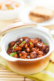 Beans in a ceramic pot on a napkin Royalty Free Stock Photography