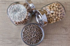 Beans, chickpeas and lentils in glass jars Royalty Free Stock Image