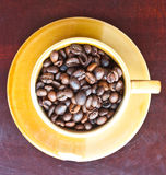 Beans coffee on brown cup Stock Image