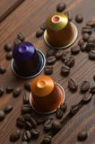Beans and coffee capsules Royalty Free Stock Image