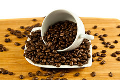 Beans of  coffee and cup on the plate drink Stock Images