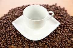 Beans of  coffee and cup on the plate drink Royalty Free Stock Photo
