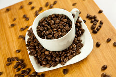 Beans of  coffee and cup on the plate drink Stock Photos