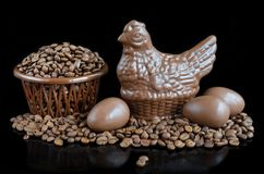 Beans coffee and figured chocolate on a black background Royalty Free Stock Photos